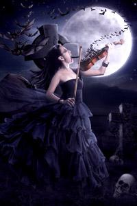 Женщина вампир на кладбище играет на